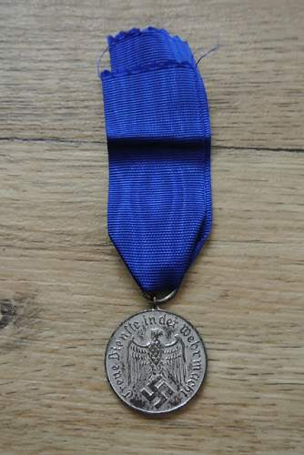 2 IAB and a Heer 4 yrs of Service medal what are they worth