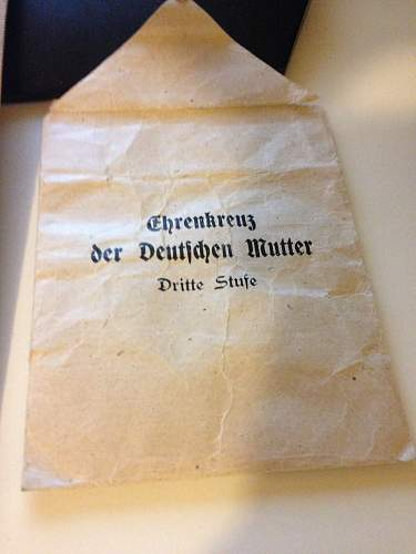Mutter Kreuz with documents.