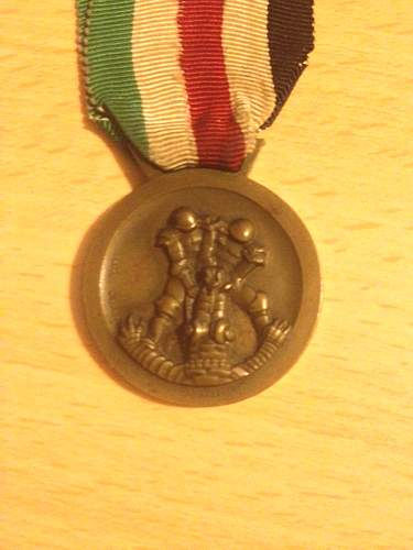 Click image for larger version.  Name:German Africa corps medal back.jpg Views:25 Size:322.1 KB ID:612607