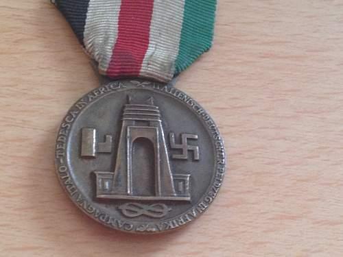 Click image for larger version.  Name:war relics dak medal 3.jpg Views:28 Size:306.3 KB ID:613686