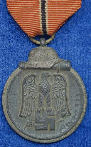 Click image for larger version.  Name:Ostmedaille L58 Obverse w-ribbon.jpg Views:170 Size:316.0 KB ID:639459