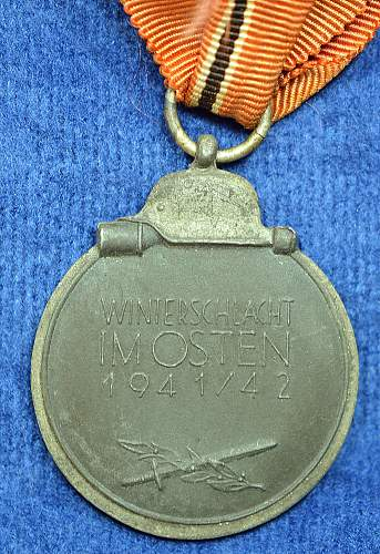 Click image for larger version.  Name:Ostmedaille L58 Reverse w-ribbon.jpg Views:61 Size:322.5 KB ID:639460