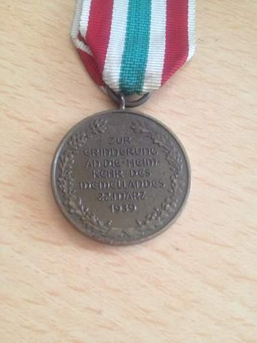 Name:  German ww2 unmarked s8l memel medal back.jpg Views: 298 Size:  20.4 KB