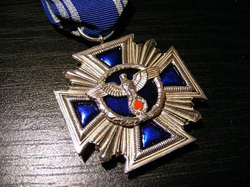 A couple of  badges original or not?