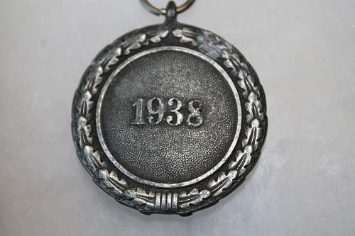 1938 medal and SA disc or medal, please help to ID