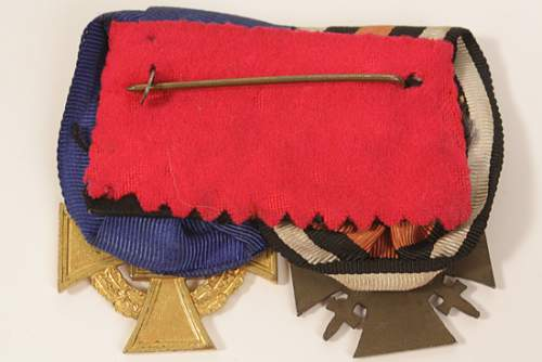 Click image for larger version.  Name:3CU40YEARSERVICEMEDALWITHHENDINBERGMEDAL.jpg Views:9 Size:19.1 KB ID:750397