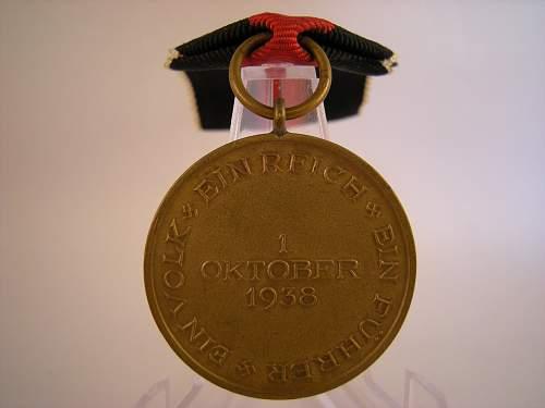 Click image for larger version.  Name:1st Oktober 1938 medal with L12 Prague spange (5).jpg Views:19 Size:351.7 KB ID:808596