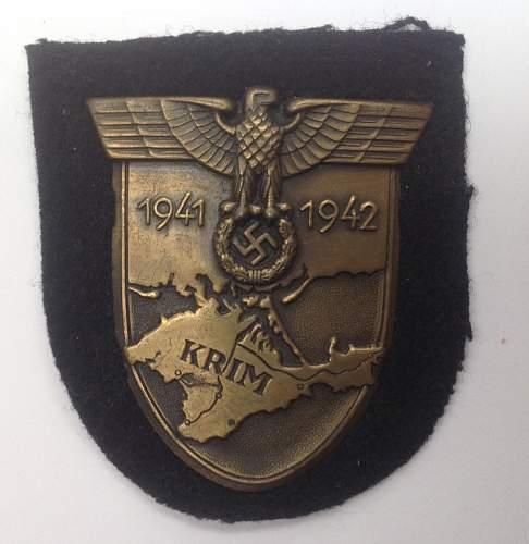 Krimschild on KM backing