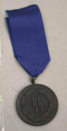 Click image for larger version.  Name:auction ss medal 1.jpg Views:97 Size:29.9 KB ID:81790