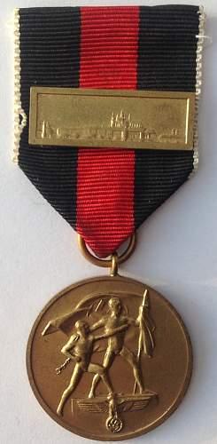 Click image for larger version.  Name:Spange zur Medaille zur Erinnerung an den 1. Oktober 1938.jpg Views:77 Size:126.1 KB ID:820675