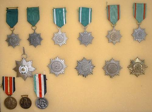 Click image for larger version.  Name:Ost Volk medals.JPG Views:35 Size:69.9 KB ID:838202