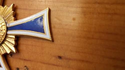 For opinions, Ehrenkreuz der Deutschen Mutter, with ribbon and boxed.