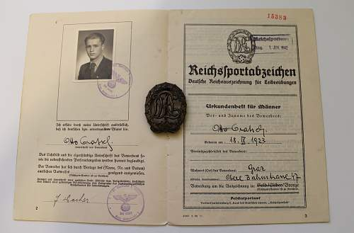 Unmarked DRL Sportabzeichen in Bronze with issue document from 1942.
