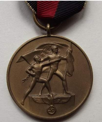 Click image for larger version.  Name:Sudetenland Medal front.jpg Views:13 Size:21.3 KB ID:976423