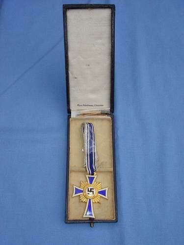 gold mutters cross