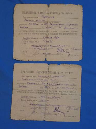 Two temporary award documents for same man, same date, both Order of Red Star