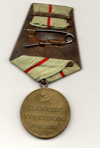Im trying to find out about this Russian award, booklet and medal