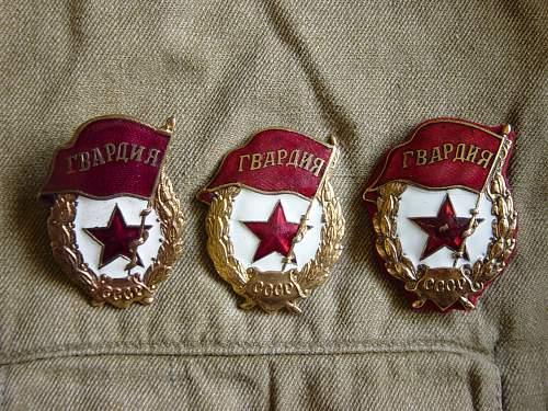 Click image for larger version.  Name:Soviet Guards badges..jpg Views:1455 Size:222.5 KB ID:27227
