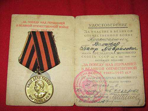 Victory Over Germany Medal & Booklet. Translation, PLEASE?