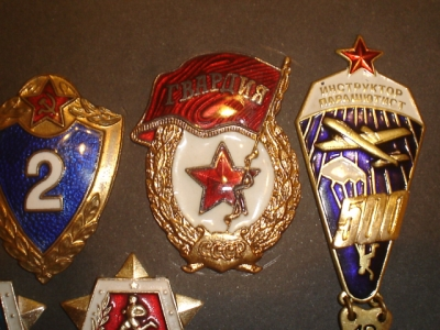 1951-1957 Russian era military badge and AK47 oiler questions