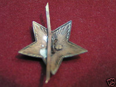 BIG Pile of M35 Cap Stars- Are ANY WWII Stars???