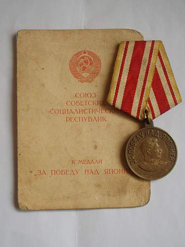 Victory Over Japan medal w/ Booklet. Authentic?