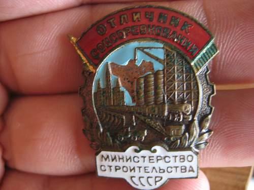 Two Soviet labor badges