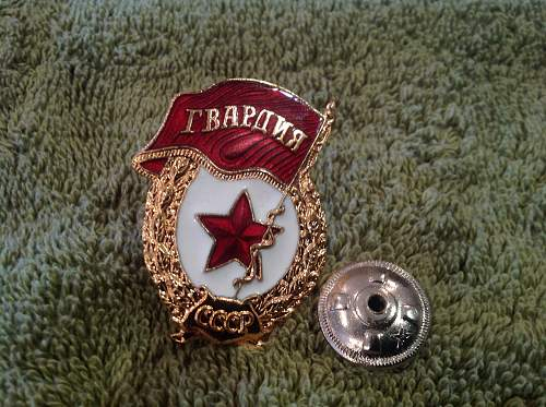 Guards badge and a numbered order