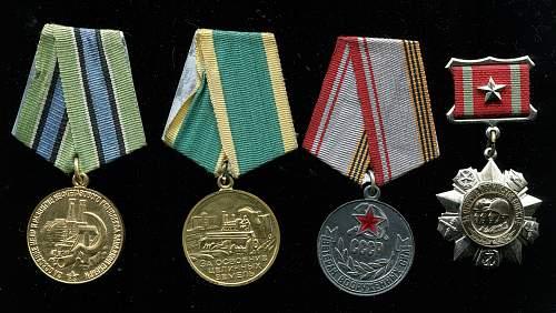 Click image for larger version.  Name:Ilya Vasilievich Kochergan, medals.jpg Views:44 Size:349.6 KB ID:806020