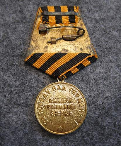 Click image for larger version.  Name:Russian_Victory_medal_back.jpg Views:16 Size:332.8 KB ID:812038