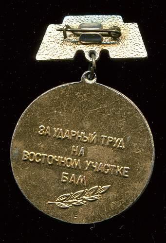 Click image for larger version.  Name:Sergei Ivanovich Barskiy, Urgal-Postyshevo Badge reverse.jpg Views:11 Size:312.6 KB ID:823176