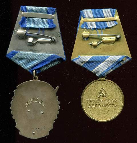 Click image for larger version.  Name:Vasiliy Illich Getmanets, medals reverse.jpg Views:5 Size:322.7 KB ID:829723