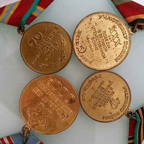 Click image for larger version.  Name:ussr_russia_cccp_medals_1422354187_16bdc316.jpg Views:44 Size:60.9 KB ID:868651