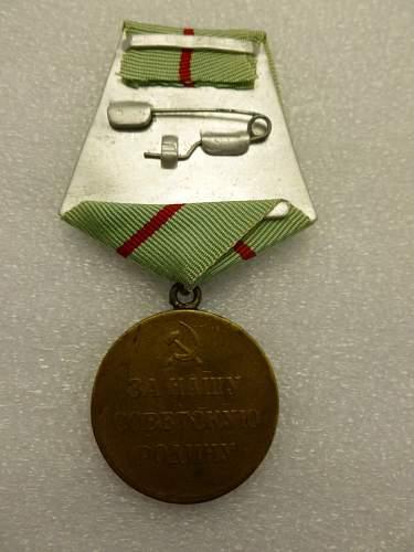 Click image for larger version.  Name:Medal Defence of Stalingrad 6.jpg Views:65 Size:147.3 KB ID:872165