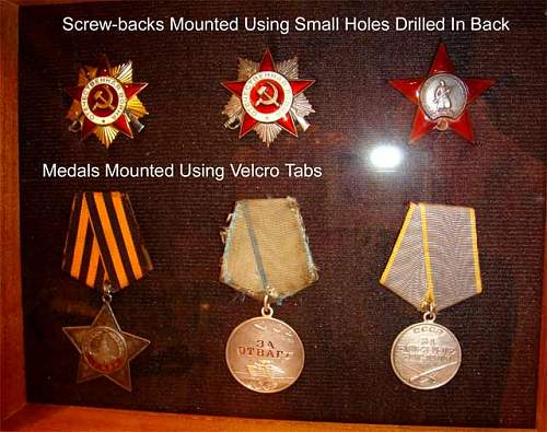 Click image for larger version.  Name:Medals-in-Shadow-Box-01.jpg Views:256 Size:48.9 KB ID:957