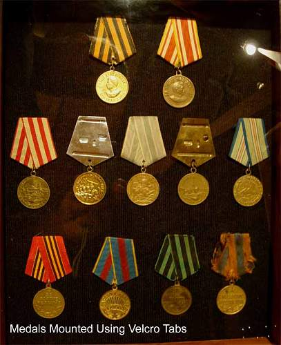Click image for larger version.  Name:Medals-in-Shadow-Box-02.jpg Views:453 Size:48.8 KB ID:958