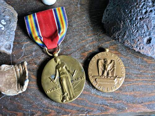 Two medals from a local shop.