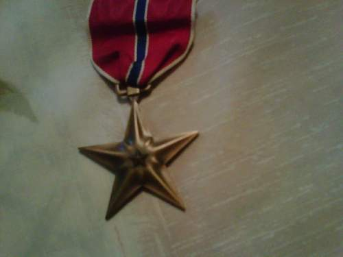 Please help me identify these medals