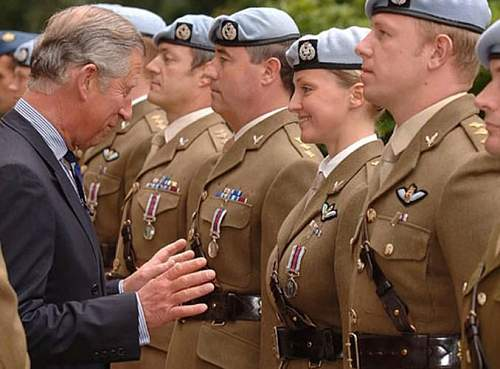Prince Charles surprised as he hands out military award