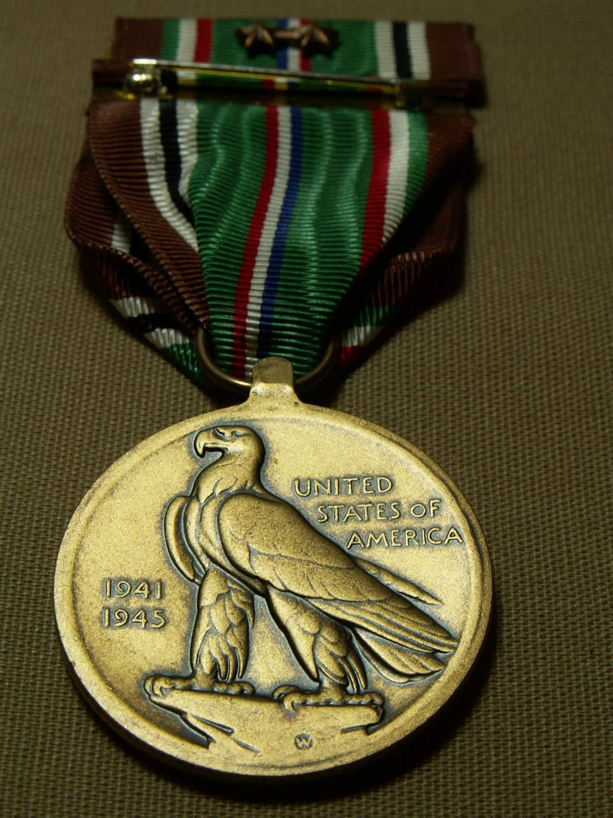 http://www.warrelics.eu/forum/attachments/orders-medals-decorations/431238d1354727865-pacific-campaign-medal-original-pict0163.jpg