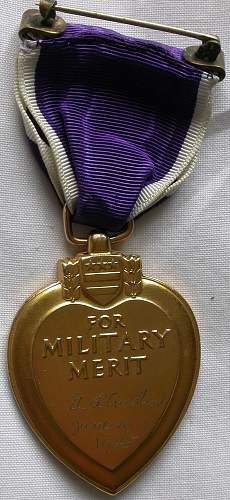 G H.W. BUSH'S mates Purple Heart and medals