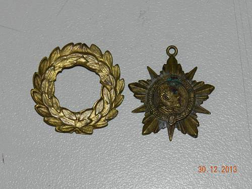 Stuck finding history on these medals