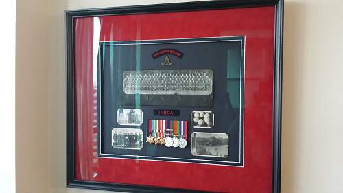 Shadow box with my great great uncles medals and pictures