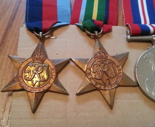 NZ group of medals. The Pacific star, BWM, 1939-45 Star, and NZ war service medal. And discharge paper.