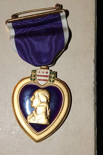 Is this purple heart officially engraved and WWII era or a replacement