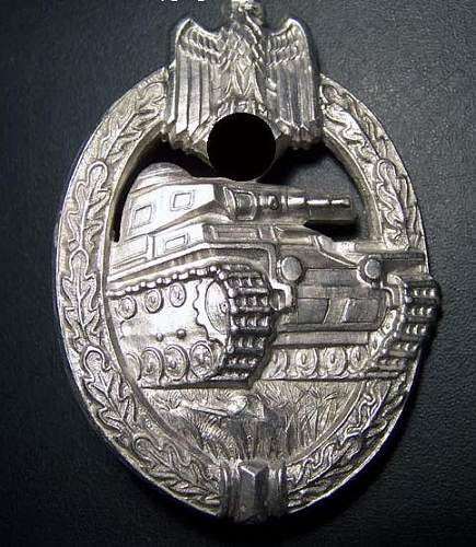 not sure about this one .... good or fake...herman aurich badge...