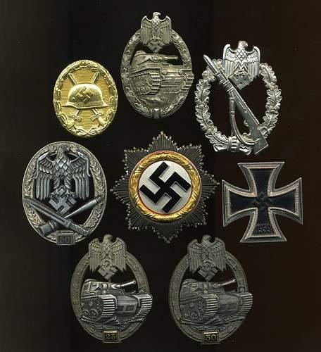 A Couple Of Juncker 1.1.1 Panzerkampfabzeichen's.