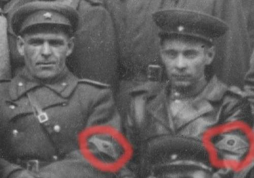 What insignia are they wearing?