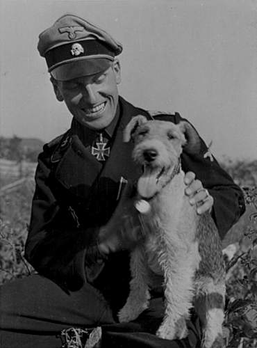 Click image for larger version.  Name:panzerman with dog.jpg Views:91 Size:163.0 KB ID:598629