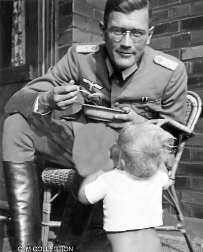 Photo of german father feeding his child